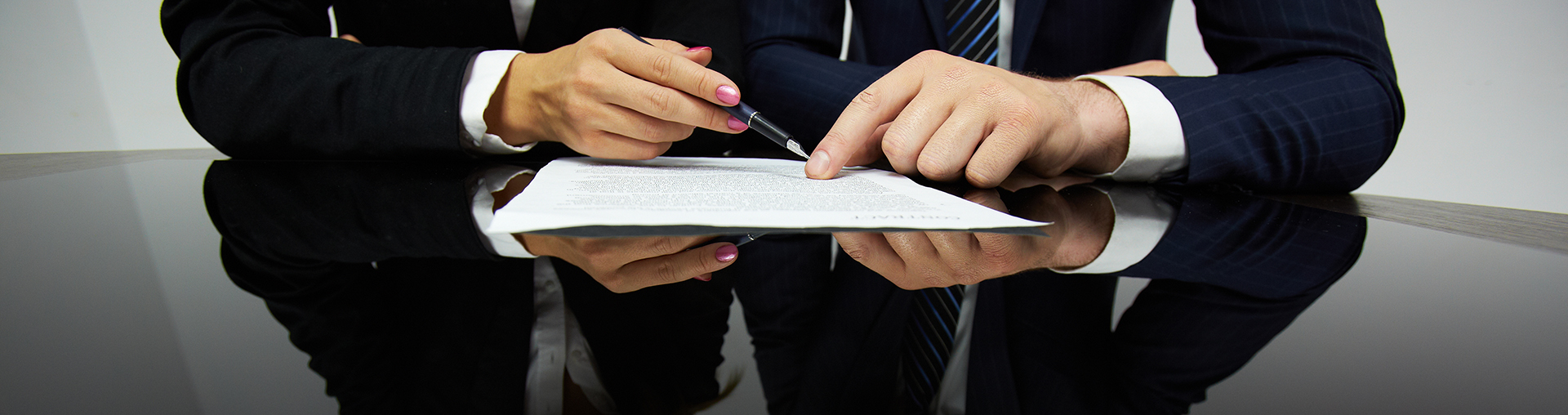 Image of human hands during reading contract